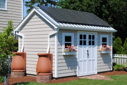 Shed with solar panels running power to our home and rain collection barrels to supply vegetable garden.Click To Enlarge