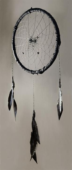 37. An old bike tire rim becomes a giant dreamcatcher.