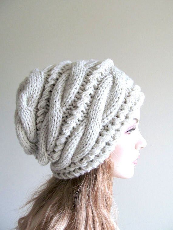 Hand made knitted slouchy hat, or beanie that made of soft chunky wool and acrylic yarn blend in the Natural Grey color. Its loose-fitted, thick and