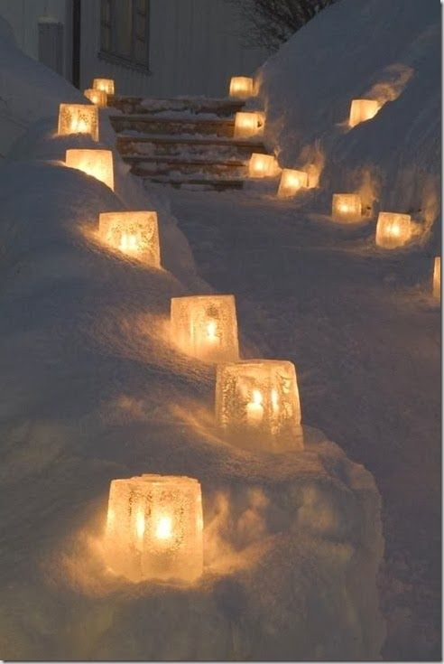 Saw this on the news the other day. Guy takes 5 gallon buckets and places a cylinder inside, then fills with water and freezes. Then places them along his driveway and puts candles in them. Really cool effect.