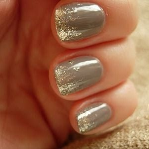 Gold flecks over gray polish. Love.