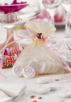 If you're going to use super cheap organza bags, bead & ribbon them.