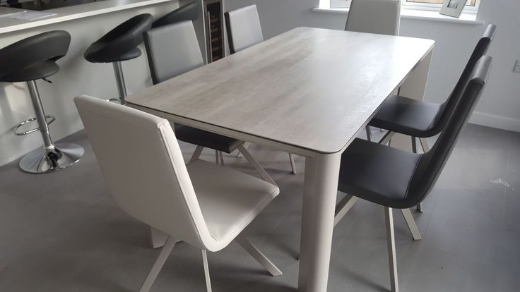 Contemporary dining set with the New York table and candy dining chairs. Table in blaze grey ceramic top and in matt gris frame. Candy dining chairs in faux leather with matching colour legs as the table. Delivered to our client in Cambridge.
