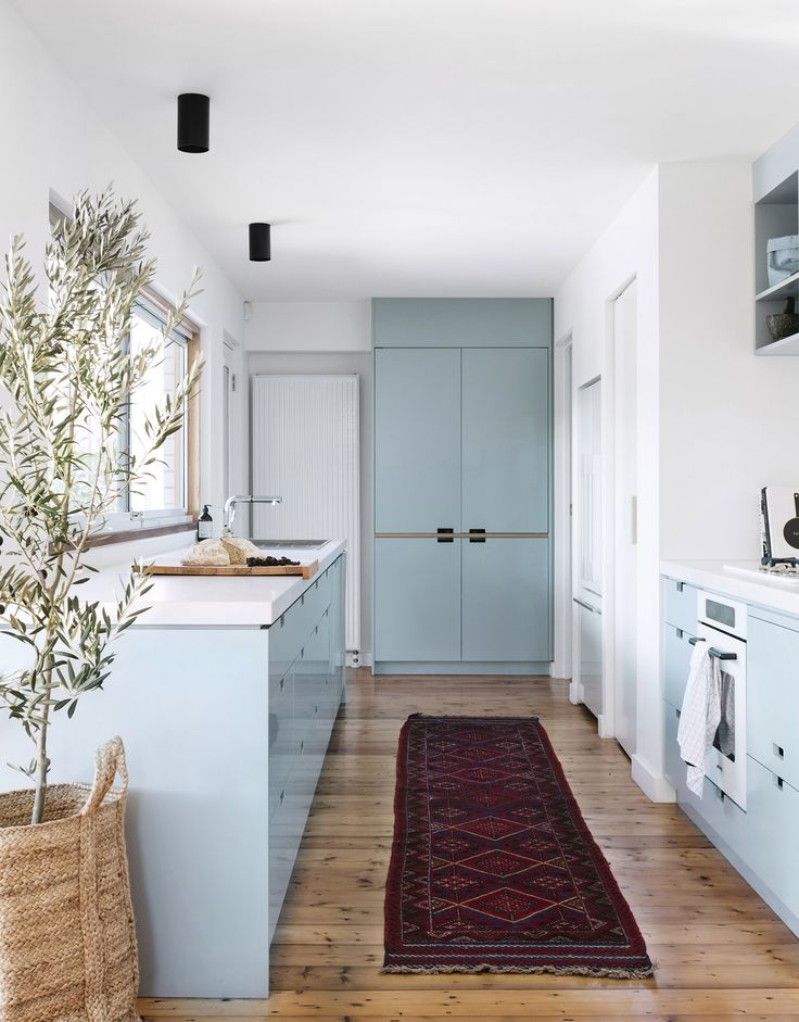 Dulux Blue Balm is the shade that creates a sense of calm in this galley kitchen in an Edwardian Melbourne family home. Photography: Emily Weaving | Styling: Ruth Welsby | Story: Australian House & Garden