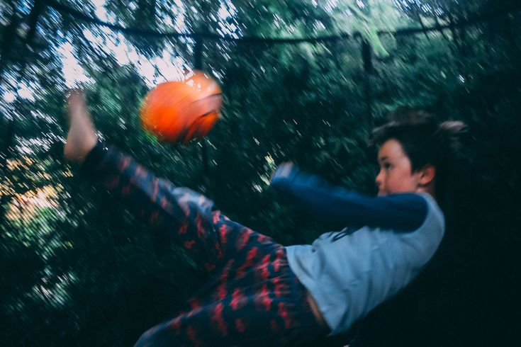 #ball #bicycle kick #blur #blurred #blurred background #boy #child #football #football trick #kick #kicking #kid #net #playing #soccer ball #soccer trick #sports #trampoline net #trick #young boy