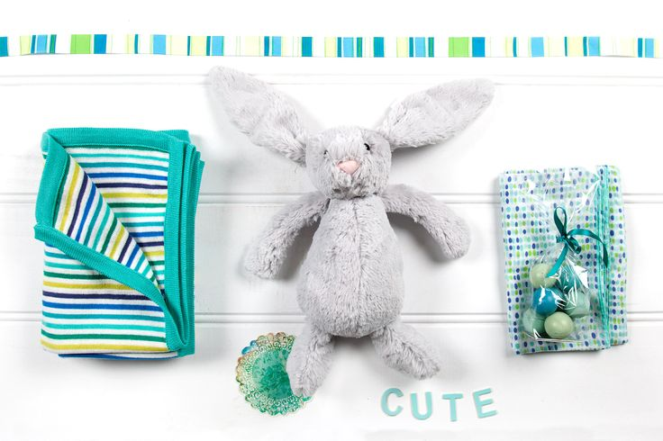 Turquoise Dream: Bashful Bunny in silver grey by Jellycat  Blanket by D Lux Baby in beautiful shades of blues  Baby Wrap in Spotty Hand Printed Cotton Gauze by D Lux Baby in shades of blue Ombre Blue Chocolate Balls by Winnow made from organic white chocolate & coconut, 130g gluten-free fair trade (made in Australia)