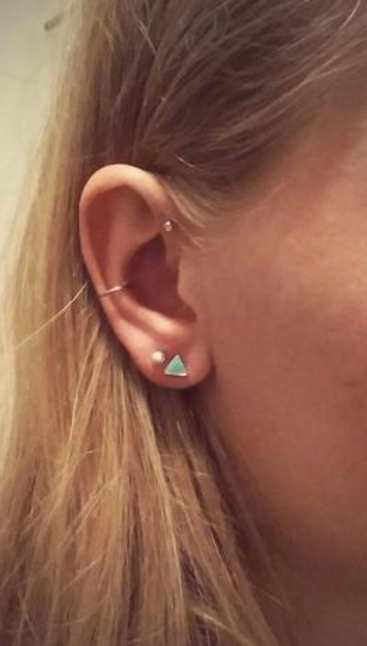 Conch and forward helix with 2 lobe piercings