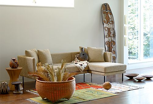 SALSA SOFA with: Basket (Botswana), Tonga Stool (Zimbabwe), Rug (Mexico), Bamboo Basket (Japan), Embroidered Cloth (Myanmar), Asmat Shield (Indonesia), Basket (Namibia)