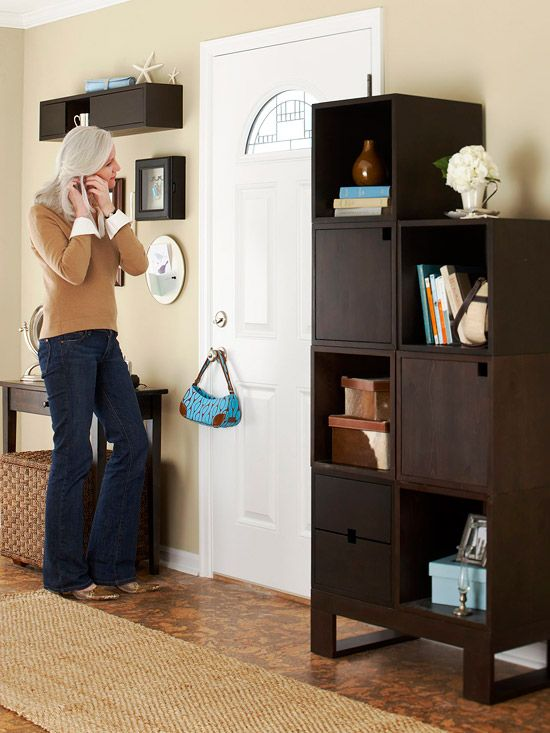 Modular cubes stack vertically and let you display some belongings while hiding others: http://www.bhg.com/decorating/storage/mudroom/do-it-all-entryways/?socsrc=bhgpin092314stylishstorage&page=15