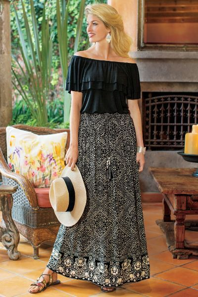 """Intricate geometrics inspired by Moorish architecture are beautifully translated onto our free-flowing maxi skirt in graphic black. Long drawstring ties with silver beaded tassels add an exotic finishing touch. Sits at natural waist with comfy, full-elastic waistband. Fully lined. Body: rayon, lining: cotton. Misses 38"""" long. Sahara Skirt II - Item #2AE31"""
