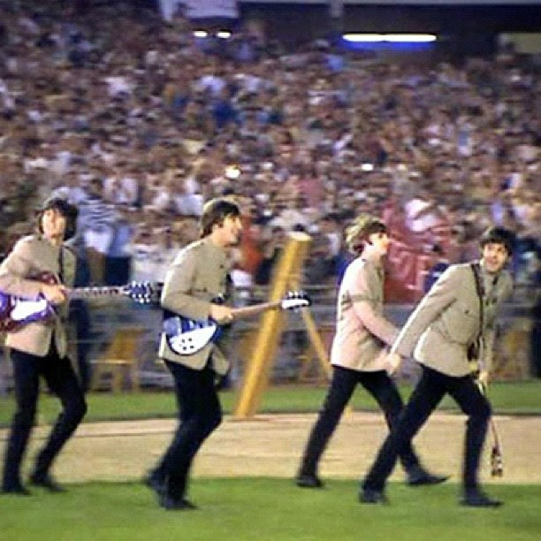 August 1965, The Beatles perform the first stadium concert in the history of rock, playing before 55,600 persons at Shea Stadium in New York City.