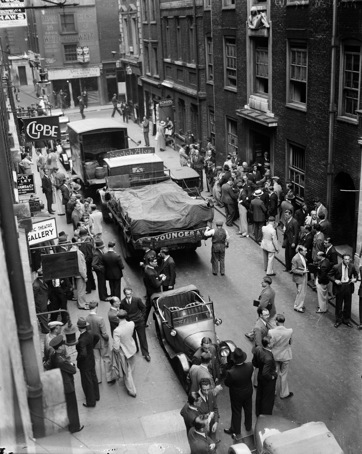 1935: In Archer St, Soho, London musicians gather in groups waiting to see if there is any work available. (Photo by General Photographic Agency/Getty Images)