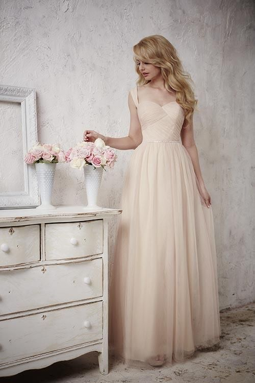 Balletts Bridal - 22897 - Bridesmaids by Jacquelin Bridals Canada - This gown presents long flowing tulle as one of its keys features, along with replica pearl and diamond accents trailing across the waist and intricate pleating done on the bodice, finishing with a sweetheart neckline and built-in tulle straps. Pictured In