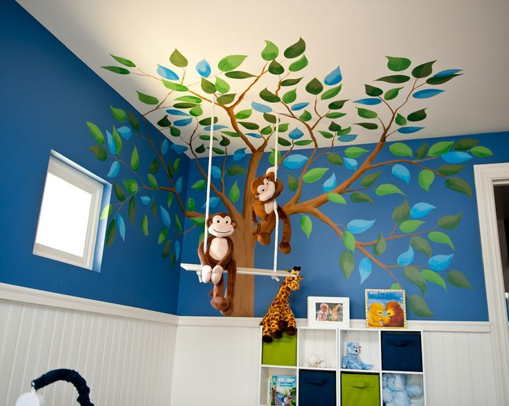 I love the way that this mural carrries on to the ceiling! It seems to make the room like a real den for the children.