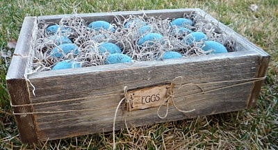 plastic eggs and old wood...I couldn't find the right old wood. so I used new wood and painted it and distressed it to look old.