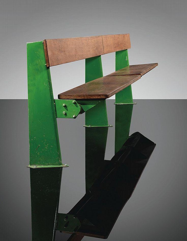 Jean Prouvé 1901  -  1984 BANC  ESCAMOTABLE,  VERS  1958 A  LARGE  GREEN  LACQUERED  STEEL  AND  OAK  FOLDING  BENCH  BY  JEAN  PROUVÉ,  CIRCA  1958.  EDITED  BY  STEPH  SIMON la  structure  en  tôle  pliée  laquée  verte,  l'assise  et  le  dossier  en  chêne Edité  par  Steph  Simon Hauteur  :  73  cm  (28    3/4    in.)  Largeur  :  260  cm  (102    3/8    in.)  Profondeur  :  46,5  cm  (18    3/8    in.)