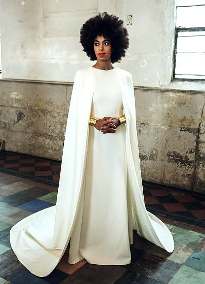 2. SOLANGE IN GOWN. Humberto Leon for Kenzo caplet gown at the Holy Trinity Church in the Bywater area of New Orleans on Sunday, Nov. 16. She accessorized with gold arm cuffs in the regal portrait captured by Rog Walker for Vogue magazine. Read more: http://www.usmagazine.com/celebrity-style/pictures/solange-knowles-alan-ferguson-wedding-album-20141711/42175#ixzz3JSjhjXhF Follow us: @usweekly on Twitter | usweekly on Facebook