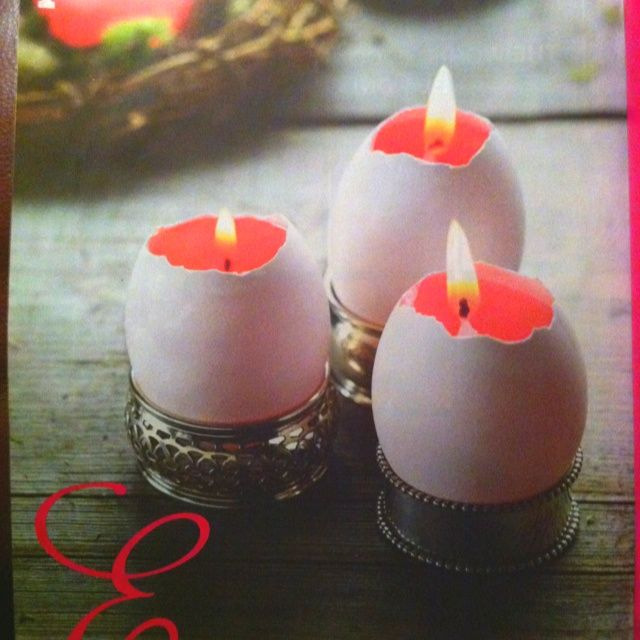 DIY Egg-Candles. Melt shredded wax into a metal container (an old can works well) over a double boiler and pour into empty eggshells. When wax is partly set (3-5 minutes) insert a small birthday candle, trimmed to size. Display in egg cups or, shown here, napkin rings!