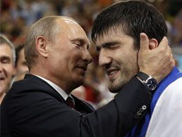 Putin, a black belt, watches Olympic judo