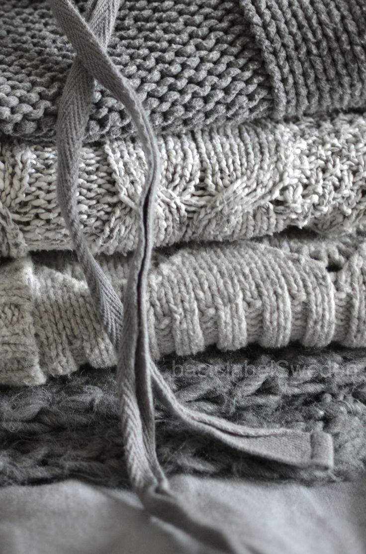 Stack of grey knitted blankets