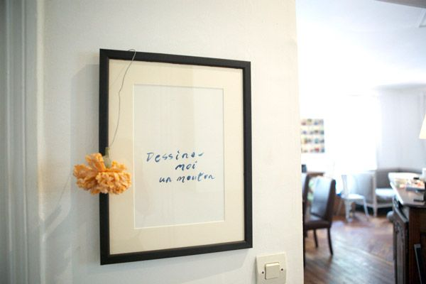 Not sure what to hang up? Take pen to paper and write down your favorite phrase, and then frame it!