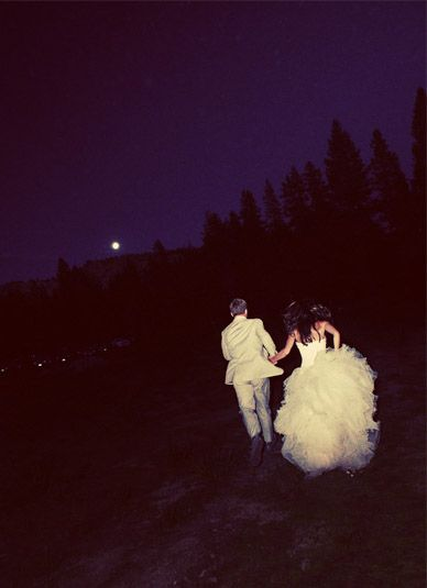 I don't think I have ever seen a night wedding pic like this before. It's awesome.. Full moon!