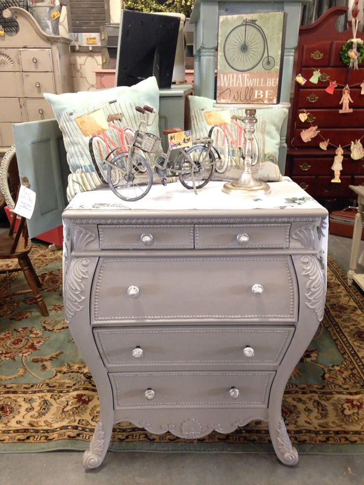 Bombay Secretary painted in Annie Sloan French Linen with a General Finishes Champagne Pearl Effects.