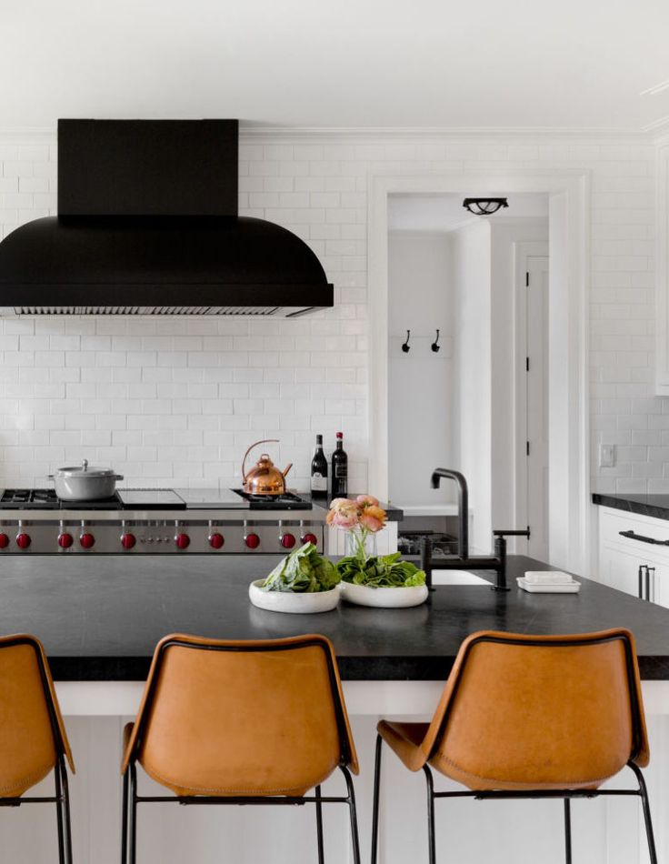modern classic black and white kitchen with leather stool and black hood | house tour on coco kelley