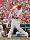 St. Louis Cardinals' Matt Adams connects for an RBI single in the first inning of a baseball game against the Cincinnati Reds, Saturday, April 18, 2015 in St. Louis. The Cardinals' Matt Holliday scored from second on the play. (AP Photo/Tom Gannam)