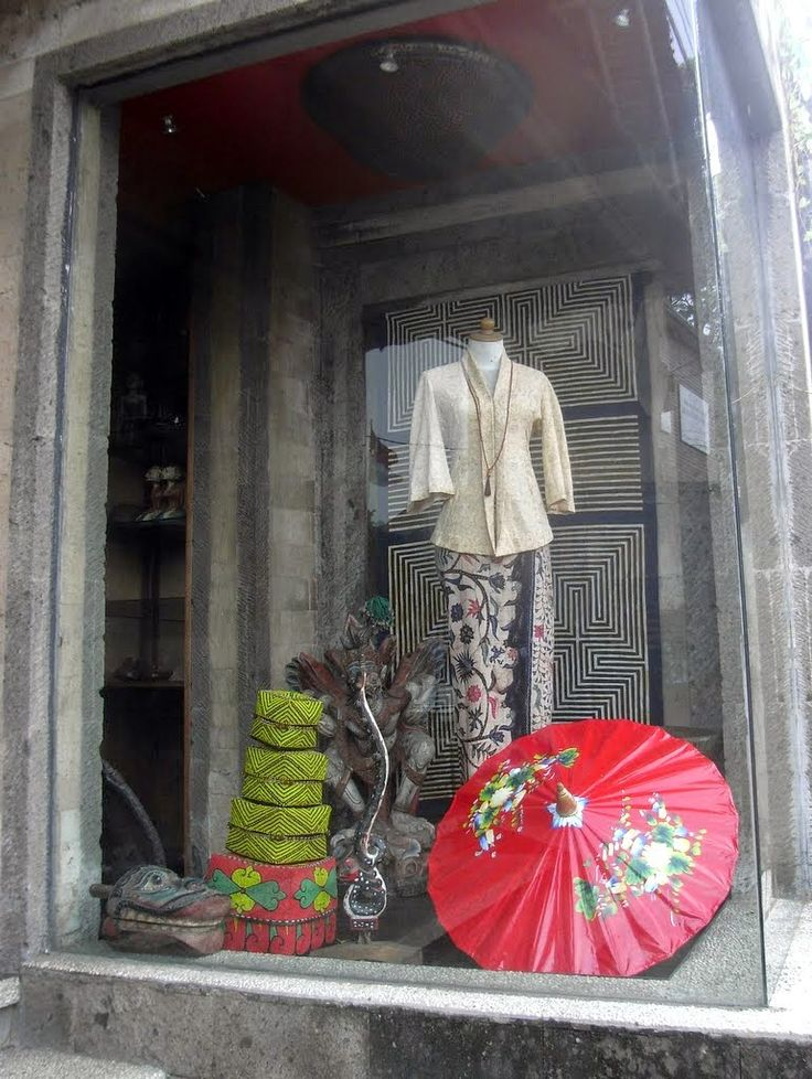 A beautiful batik and parasol display in the window of Oka Kartini on Jalan Raya Ubud, Bali, Indonesia.