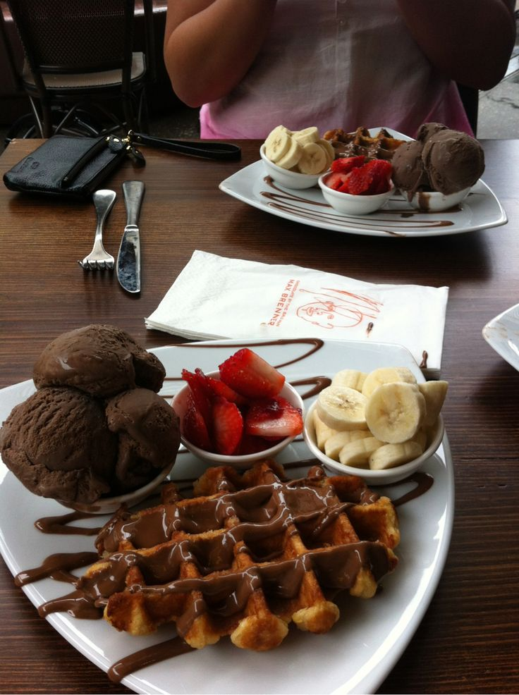 Waffles with chocolate sauce and ice cream, strawberries and bananas