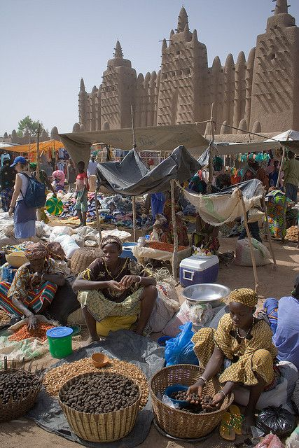 Market day in front of the Great Mosque of Djenne - the largest mud brick building in the world!