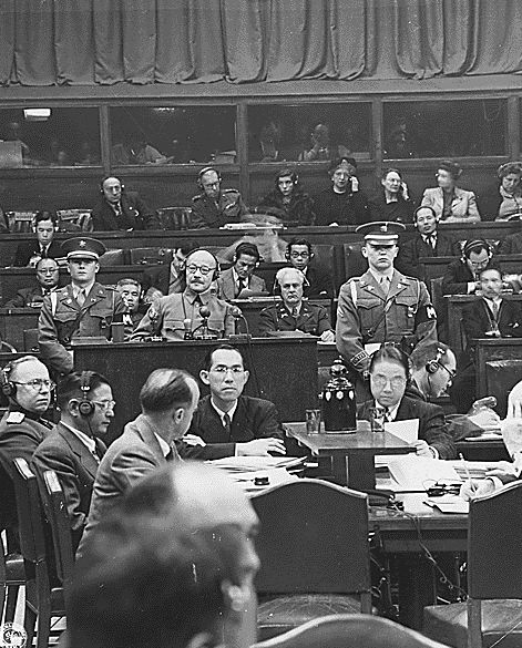 Tojo before the International Military Tribunal for the Far East. By Unknown - NRE-338-FTL(EF)-3161(12), Public Domain.