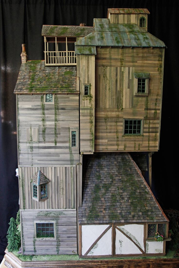 The back exterior of the Burrow in the Harry Potter series is the home of the Weasleys.  By Sally Wallace and Rik Pierce.