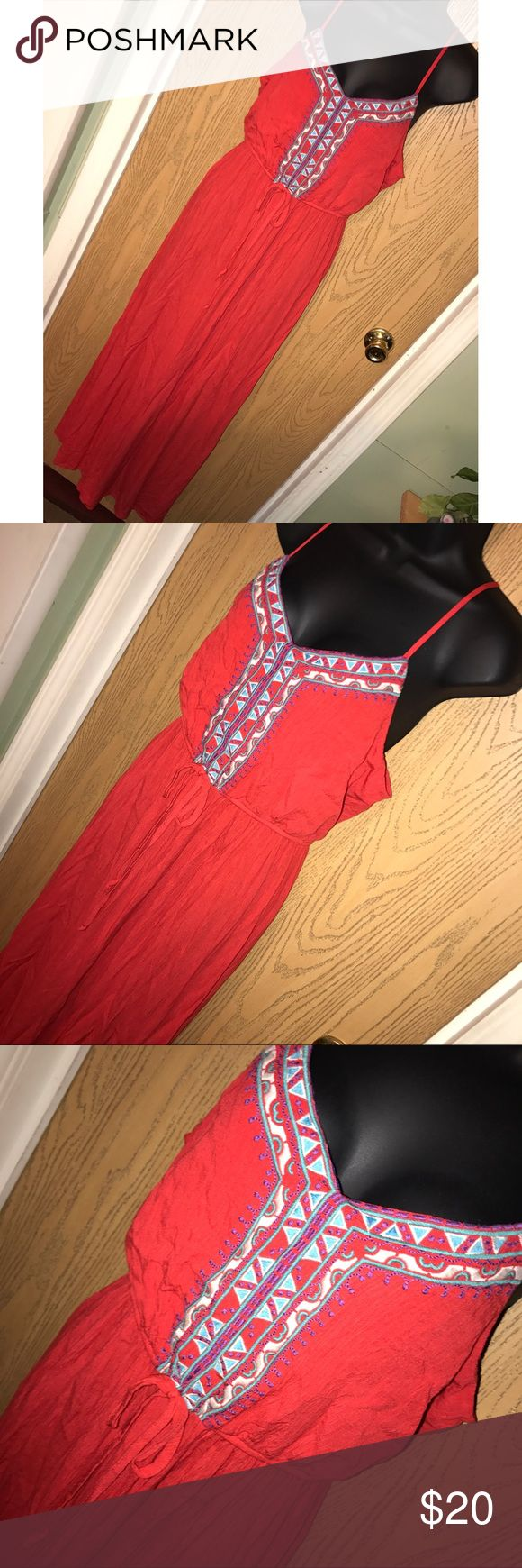 """Red Aztec front boho maxi dress Super pretty red/coral boho maxi dress with embroidered Aztec design in the front and waist tie. Has a keyhole on the back. Great used condition. 20"""" from armpit to armpit, 49"""" from armpit to hem. Lily Rose Dresses Maxi"""