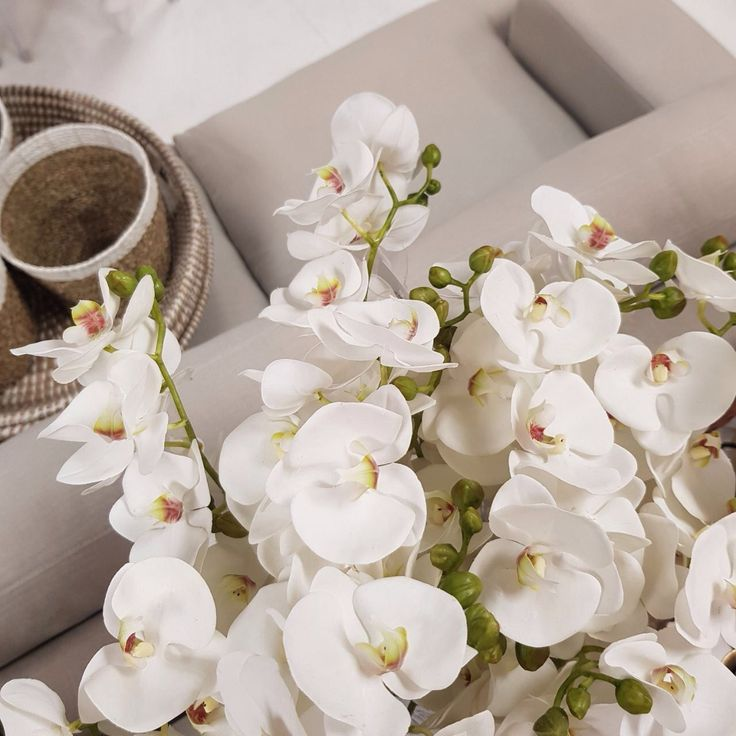 Beautiful Faux orchid flowers that won't fade and look and feel so real! Add a floral element to your decor to brighten your space. #fauxflowers #floral #decor