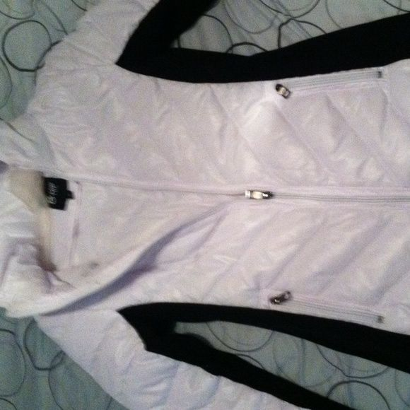 Brand new Black and White winter puffer jacket BRAND NEW ONLY WORN ONCE! the black panels are a thick cloth material. there's a little pulling on the stitch inside the arm fold. Jackets & Coats Puffers