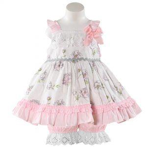 Vaatteita tytöille. Miranda textilesin kuviollinen mekko sekä pitsireunuslahkeiset housut tytölle. Vauvanvaatteita ja lastenvaatteita www.nellikki.fi