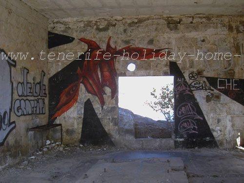 Graffiti inside a ruin by a real window towards Beach Playa de las Gaviotas Tenerife.