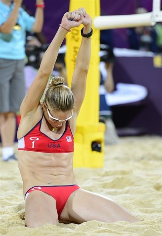 Kerri Walsh celebrates winning the gold medal after defeating April Ross and Jennifer Kessy (USA) in the women's beach volleyball gold medal match