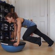 """Our clients always wonder, """"what is that half-ball thing, and how do I use it?"""". Well, that crazy piece of workout equipment is called a BOSU, and it's one of our favorite pieces of equipment to target your abs and your core. The whole idea of the Bosu is to create and unstable surface making …"""