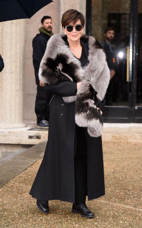 Kris Jenner arriving at Miu Miu in all black and a fur wrap