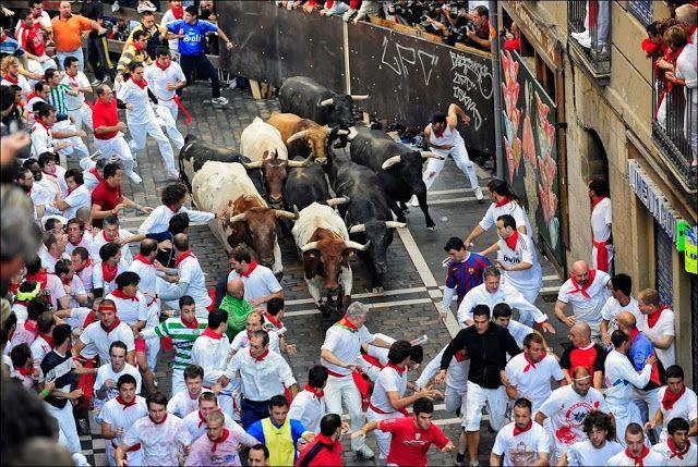 Running with Bulls in San Fermin Festival Spain