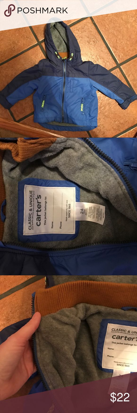 Carters fall or spring jacket. 24 Month Carters jacket washed and never worn.  Hood, fleece lining with a waterproof type exterior. Blue with gray interior.  Good for the car! Carter's Jackets & Coats