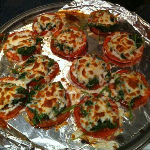 Tomatoes soaked in balsamic vinegrette for 4 hours, bake at 350 for 7 minutes, then topped with sautéed garlic and spinach, and cheese and baked for an additional few minutes until cheese is crisp.