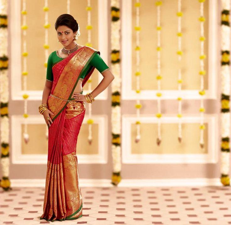 South Indian bride. Hindu bride. Tamil bride. Telugu bride. Malayalee bride. Amala Paul. Red silk kanchipuram sari with contrast green silk blouse. South Indian wedding.