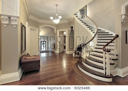 Curved Staircase Taupe Grey Paint Dark Wood White Trim