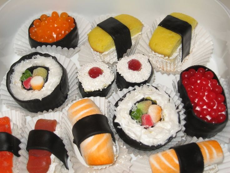 Candy sushi and sashimi!  I plan to make these using Rice Krispie Treats, red Swedish fish, and Froot by the Foot cut into slender strips to use as seaweed.  Yummo!  I love how this person used the white sprinkles to mimic rice; very clever.