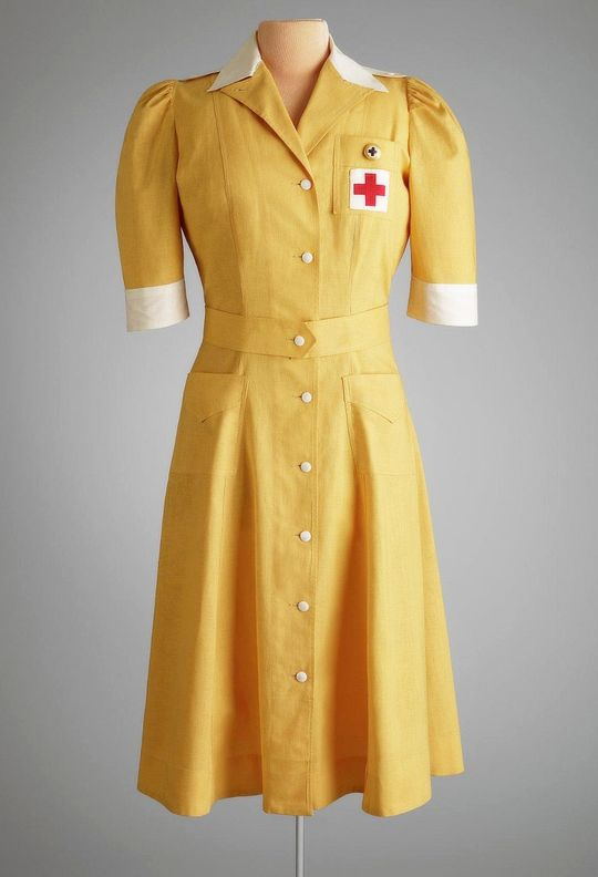 vintagegal:  American Red Cross Volunteer Uniform, USA: Baltimore, MD c. 1941-1942   I'm not the type of person who really wears mustard, but this dress is pretty cute.. cute as fuck actually