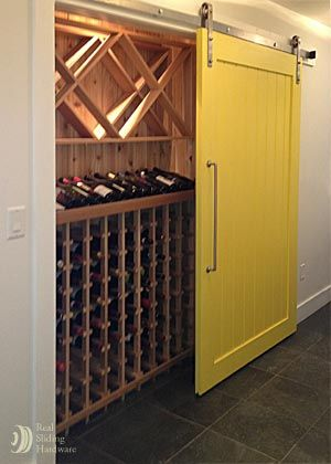 Wine closet sliding barn door. simple wine cellar for limited space ....